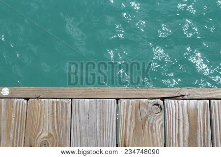 Standing On The Dock Over A Blue Ocean