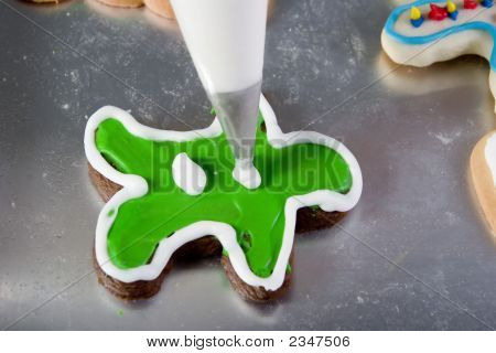 Decorating A Christmas Gingerbread Man