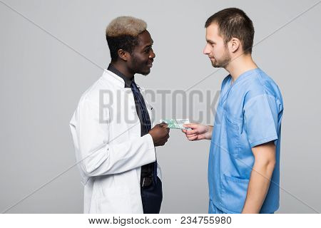 Medical Surgeon Share Bribing Money With Doctor, Giving Money Isolated On Gray Background