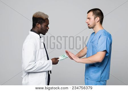 Medical Surgeon Refuse Bribing Money From Doctor Isolated On Gray Background
