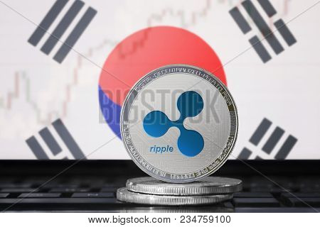 Ripple (xrp) Cryptocurrency; Physical Concept Ripple Coin On The Background Of The Flag Of South Kor