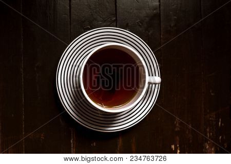 Top View Of A Big Teacup And Teabag On Rustic, Wood Backgound With Copyspace