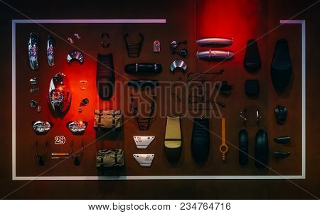 Display  Of Motorcycle Accessories And Spare Parts Arrangement Hanging On Wooden Wall For Motorcycle