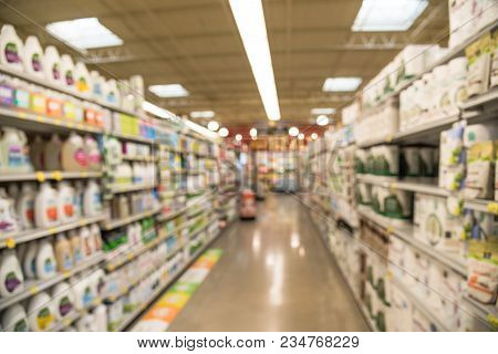 Blurred Image Of Cleaning And Paper Goods Aisle At  Groceries Store In Usa
