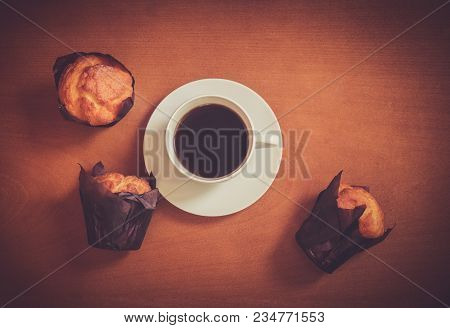 Coffee And Muffins On Wooden Background. Top View With Copy Space.