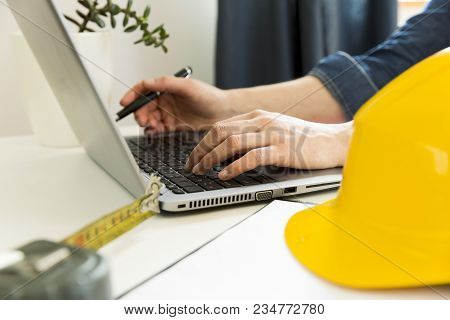 Young Female Architect And Designer Working On Blueprint Project. Contractor Architect Concept