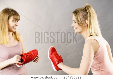 Agressive Women Having Argue Fight Using Shoes, Female Friend Being Scared. Violance Concept.