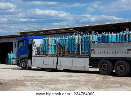 Truck For Transportation Of Gas Cylinders. The Car Delivers Gas To The Shops, Restaurants And Reside