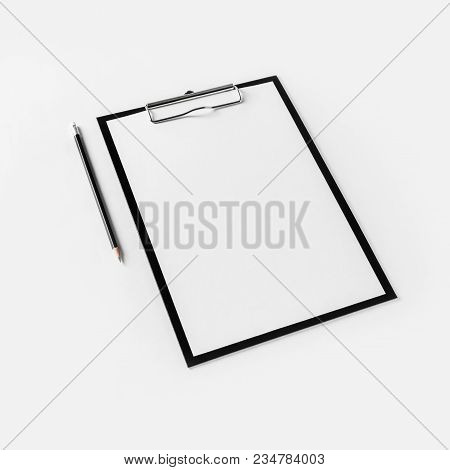 Clipboard With Blank Letterhead And Pencil On White Paper Background.