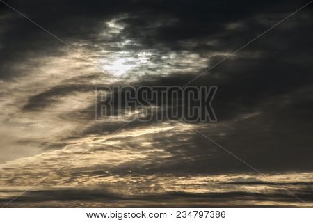 Dark Clouds In Front Of A Setting Sun