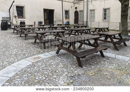 Series Of Wet Empty Wood Tavern Style Tables