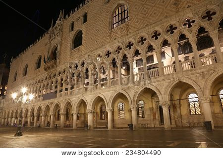 Ducal Palace Also Called Palazzo Ducale In Italian Language And Street Lamps At Night With Long Expo