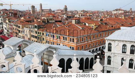 Venice, Italy - February 5, 2018: Rialto Bridge And Many Venetian Houses