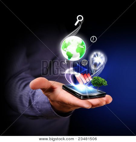 Hand of a businessman holding financial symbols