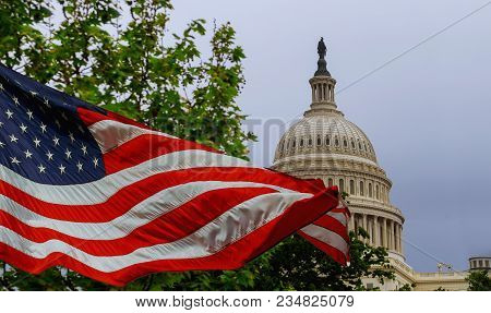 The Us Capitol Building With A Waving American Flag Superimposed On The Sky Capitol Hill In Washingt