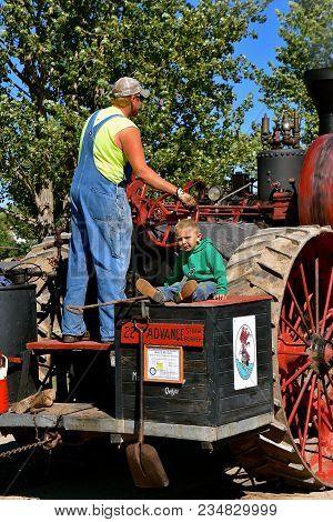 Dalton, Minnesota, Sept 8, 2017: An Unidentified  Father/son Combo Operate An Advance Steam Engine A