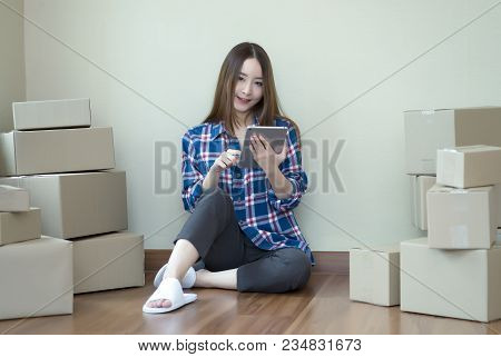 Young Casual Beautiful Woman Using Tablet Startup Small Business In The House Look At The Camera, Sm