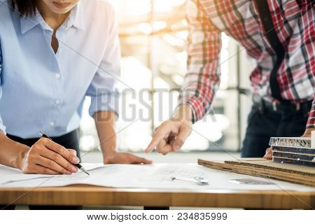 Close-up Of Person's Engineer Hand Drawing Plan On Blue Print With Architect Equipment, Architects D