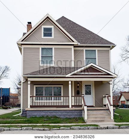 Two Story House with Spindle Porch Railing