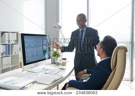 Happy African-american Entrepreneur Showing Results Of His Work To Entrepreneur