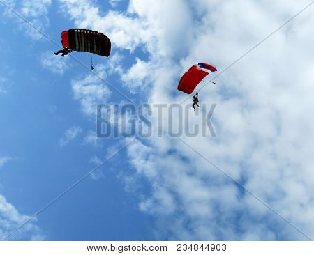 Skydivers Jump From An Airplane In The Sky.