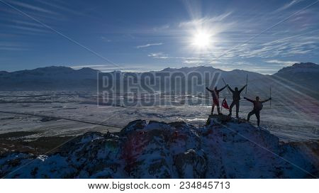Struggling Mountaineers Reaching The Summits Of The Mountains