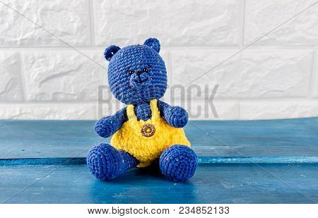 Cute Handmade Blue Bear Toy On A Brick Wall Background, Copy Spase