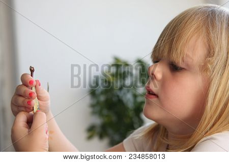 Portrait Of Cute Young  Girl With Blond  Hair Playing