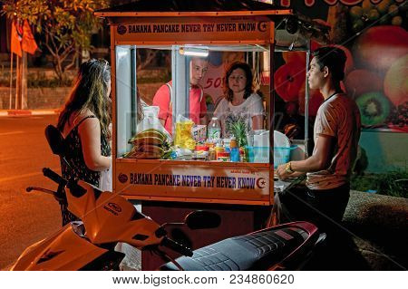 Thailand, Phuket, March 19, 2018 - Concept Of Street Food Cheap In Asia. Truck Trader Pancakes On Th