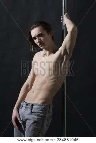 Macho With Naked Chest, Athlete, Sportsman, Dancer Performing Pole Dancing Moves. Sexy Dancer Concep