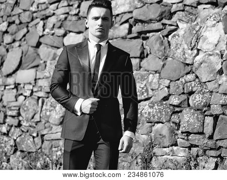 Man Young Handsome Elegant Model Wears Suit White Shirt With Black Skinny Necktie Looks In Camera Po