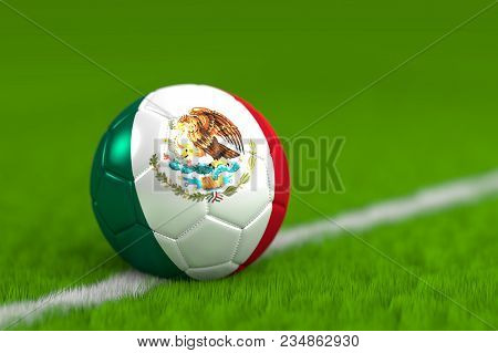 A Soccer Ball With Flag Of Mexico On Green Grass.