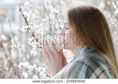 Young Woman With Closed Eyes Drink A Tea. Enjoying The Spring