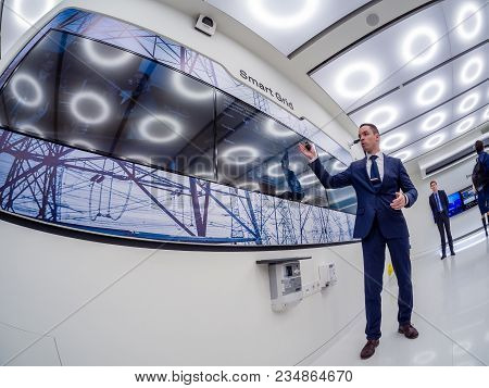 Moscow, Russia - April 3, 2018: Huawei Russia Manager Presents Demo Stand Smart Grid At Event Openin