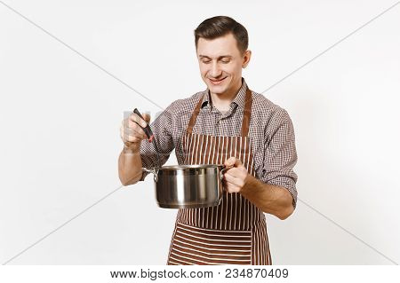 Man Chef In Striped Brown Apron Holding Silver Stainless Glossy Aluminium Empty Stewpan, Pan Or Pot,