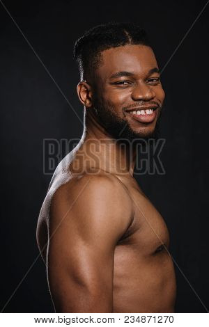 Portrait Of Handsome Shirtless Young Muscular African American Man Smiling At Camera Isolated On Bla