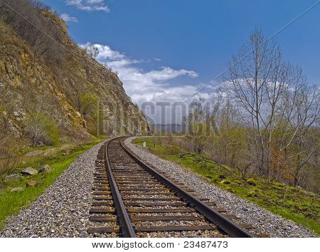 The Tumbling of railway linen beside declivity of mountain poster