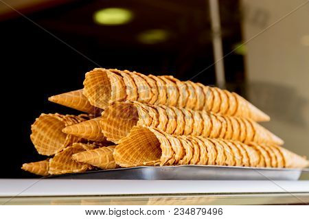 Freshly Baked Ice Cream Waffle Cones With Chocolate Coating On Top Sitting On The Silver Stand