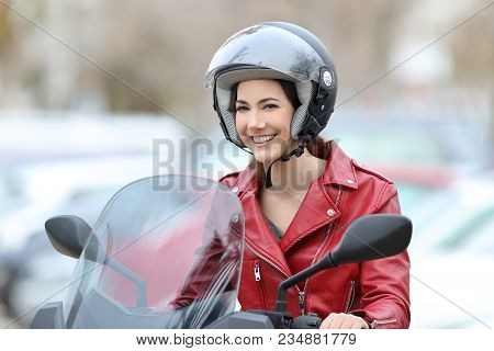 Happy Biker Sitting On A Motorbike Looking At You On The Street