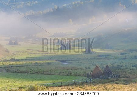 Beautiful Rural Mountain Landscape In The Sunrise Light With Morning Fog, Fundatura Ponorului, Huned