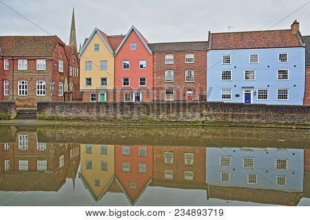 The Riverside (river Wensum) In Norwich (norfolk, Uk) With Reflections Of Colorful Houses And The To