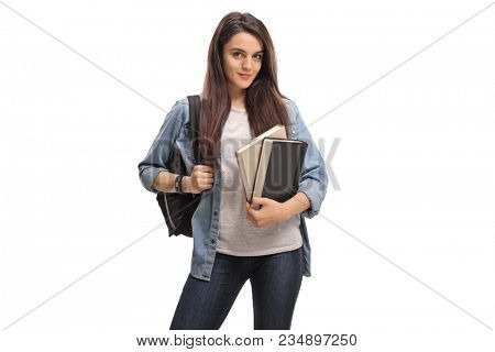 Female teenage student with a backpack and books isolated on white background