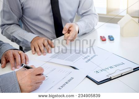 Car And Home Insurance Concept, Broker Agent Presenting And Consult To Customer To Decision Making S