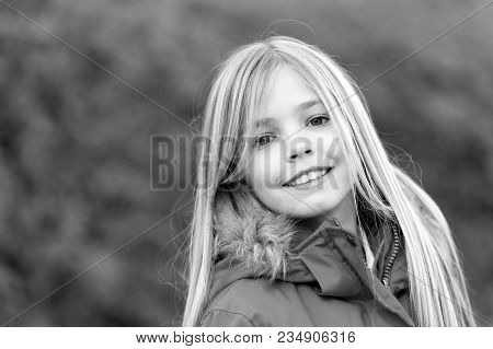 Innocence, Purity And Youth. Girl With Blond Long Hair Smile On Natural Environment. Happy Childhood