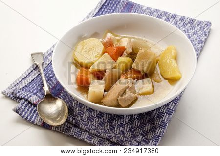 Classic Irish Stew With A Spoon And Deep Plate With Home Growen Vegetable