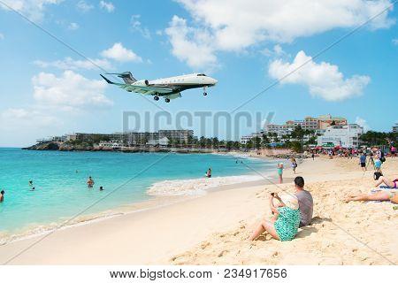 Philipsburg, Sint Maarten - February 13, 2016: Jet Flight Land Over Maho Beach. Plane Low Fly On Clo