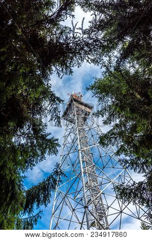 Look To Transmitter Telecommunication Tower From The Ground. Gsm And Television Signal, Touristic Lo