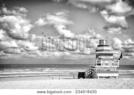 Lifeguard Tower For Rescue Baywatch On South Beach In Miami, Usa. Red And White Wooden House On Sea