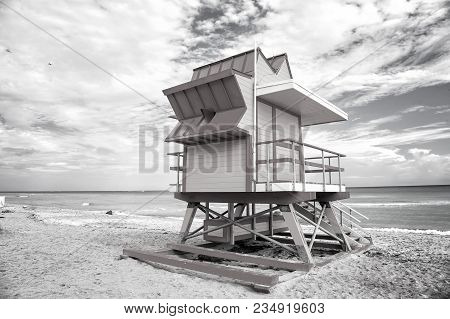 Lifeguard Tower For Rescue Baywatch On South Beach In Miami, Usa. Red And Yellow Wooden House On Sea