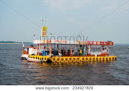 Manaus, Brazil - December 04, 2015: Petrol Station And Shop On Pontoon Raft Float In Sea On Blue Sky